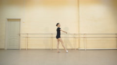Young caucasian ballerina girl showing various ballet steps and positions Stock Footage