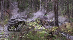 Driving the ATV in the mud and forest Stock Footage