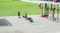 Train weightlifters in the open air Stock Footage