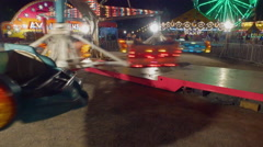 Fall Fair Medium wide shot panning up while ride spins people around just off Stock Footage