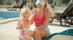 Beautiful young woman with a small daughter at the pool Stock Footage