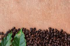 Coffee beans on grunge wooden background Stock Photos