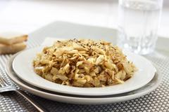 Fried cabbage with caraway and garlic on a plate Stock Photos