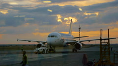 Airdrome trucks is the plane on the runway Stock Footage