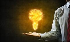 Bright idea for success achieving Stock Photos