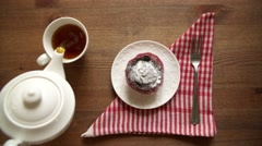 Muffin baked chocolate cake. the Girl delivered cake on a wooden table Stock Footage