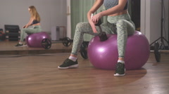 Close up of sportswoman lifting dumbbells in front of camera in the gym Stock Footage