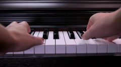 To play the piano, hands playing the piano Stock Footage