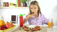 4K Child Eating Pizza, Drinking Oranges Juice in Kitchen Kid Eats Unhealthy Food Stock Footage