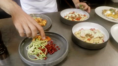 Mid-section of chefs garnishing food Stock Footage