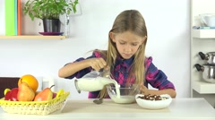 4K Girl Eating Cereals, Milk at Breakfast, Child Face Preparing Meal in Kitchen Stock Footage