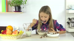 4K Child Eating Breakfast, Hungry Young Girl Eats Cereals and Milk in Kitchen Stock Footage