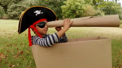 Boy pretending to be a pirate Stock Footage