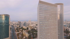 Aerial overhead view Tel Aviv city skyscrapers Azrieli, Electra at sunset / sunr Stock Footage