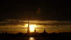 Stunning sunset against Peter and Paul cathedral spire silhouette, sun go down Stock Footage