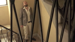 desperate young father on the stairs Stock Footage