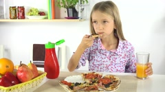 4K Girl Eating Pizza, Drinking Oranges Juice in Kitchen, Kid Eats Unhealthy Food Stock Footage