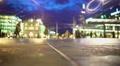 Evening city life, many people walking on square near illuminated shopping mall 4k or 4k+ Resolution