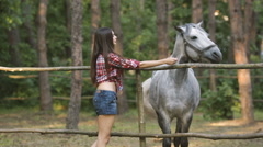 Woman and Horse. Casual Sexy Style Stock Footage