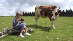 4K Cowherd Child Playing Tablet, Pasturing Cows, Girl Using Smart Phone, Cattle Stock Footage