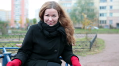 Pretty Caucasian woman in red gloves saying to camera and making turnabout Stock Footage