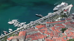 Aerial view at the port in Kotor city. The Gulf of Kotor (Boka Kotorska) Stock Footage