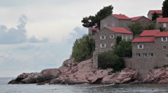 Walls and fortifications of Sveti Stefan island and hotel are on huge rock Stock Footage