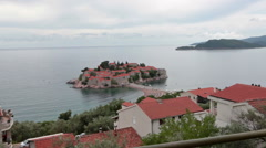 Observing place with coin operated telescope is on the hill of Sveti Stefan town Stock Footage