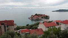 The Sveti Stefan city and islet in sea. Top view at coastline. Montenegro Stock Footage