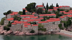 Close up view at the walls and fortifications of Sveti Stefan island and hotel.  Stock Footage