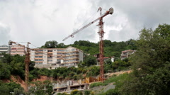 Camera review of construction site of hotel buildings on hills. Jaz beach, Budva Stock Footage