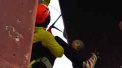 An experienced climber climbs the mountain. Motivation. Success Stock Footage