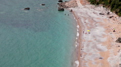 Empty sandy nude beach next Jaz main beach. Aerial view, waterfront. Montenegro Stock Footage