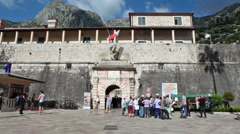 Main gate and entrance of Kotor old town and fortress are full of visitors group Stock Footage