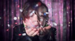4k Disco and Bright Background with a Performer Child Blowing Confetti Stock Footage