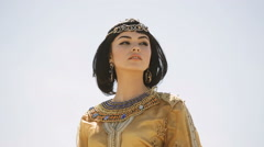 Beautiful woman with fashion make-up and hairstyle like Egyptian queen Cleopatra Arkistovideo