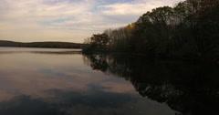 Housatonic River Sandy Hook CT dark shoreline follow Stock Footage