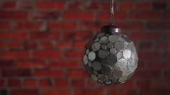 Mirror Christmas ball on the brick wall background. Stock Footage