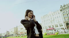 Attractive lady talks on phone and smiles at beautiful sight Stock Footage