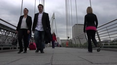 4K London Hungerford Bridge, People Tourists Walking and Crossing Thames River Stock Footage
