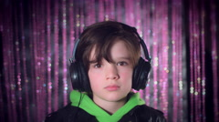 4k Disco and Bright Background with a Performer Child posing Sad with Headphones Stock Footage