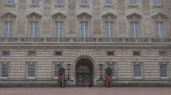 London Buckingham Palace, Armed English Guard Marching and Guarding Stock Footage