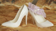 Wedding shoes and wedding pink garter. Close up Stock Footage