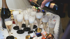 A lot of glasses of sparkling wine on the table Stock Footage