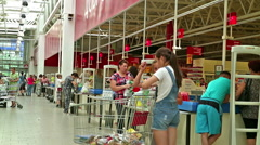 Row cash desks in the supermarket. Many buyers Stock Footage