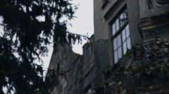 Spooky dark castle house Halloween with bright vintage window Arkistovideo