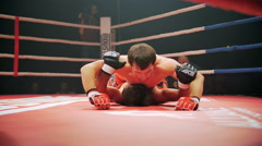Belgorod, Russia - Athletes in the ring mixed martial arts Stock Footage