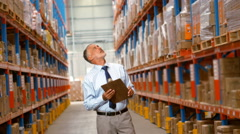 Manager maintaining stock on a clipboard Stock Footage