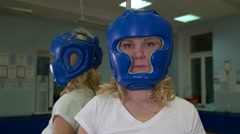 Beautiful Kickboxing woman training punching bag in fitness studio fierce Stock Footage