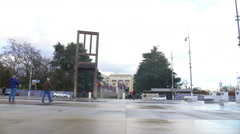Broken Chair monument in front of Palace of Nations in Geneva, Switzerland Stock Footage